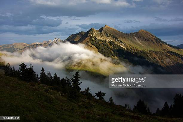 Scenic View Of Alps Against Sky During Foggy Weather