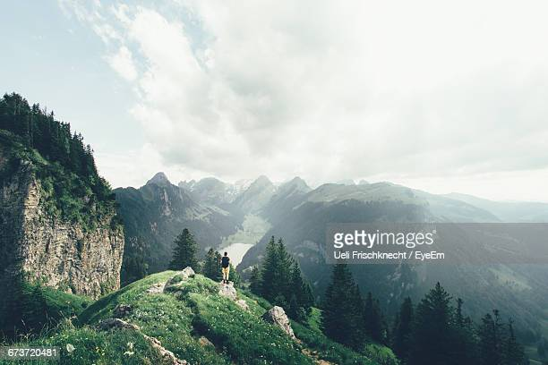 Scenic View Of Alpstein Mountains Against Cloudy Sky