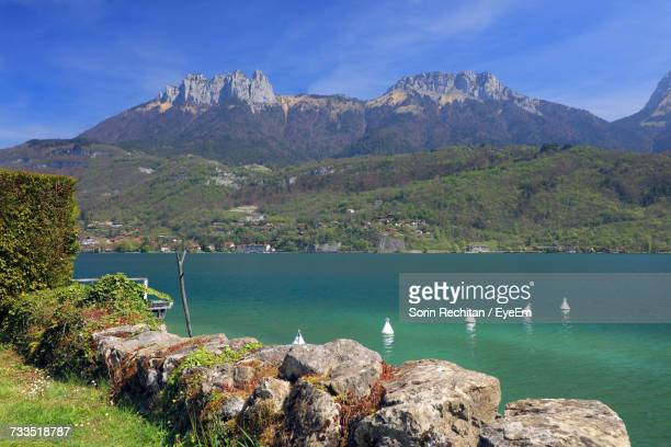 scenic view of annecy lake and mountains - lake annecy stock photos and pictures