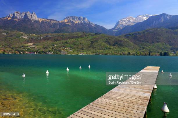 scenic view of annecy lake and mountains - haute savoie fotografías e imágenes de stock