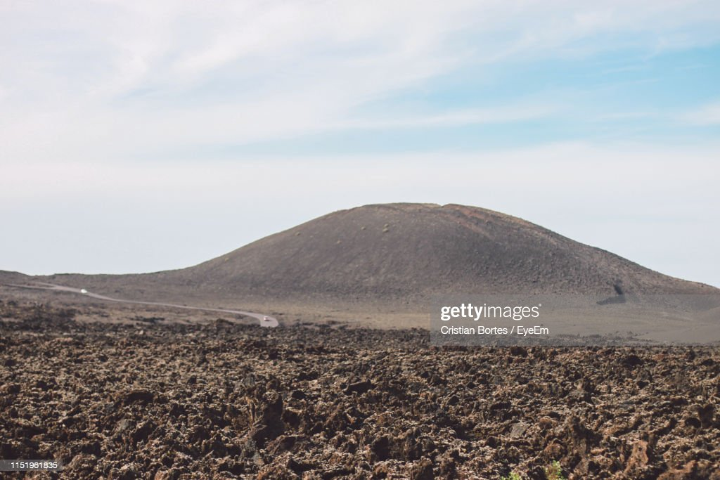 Scenic View Of Arid Landscape Against Sky : Stock Photo