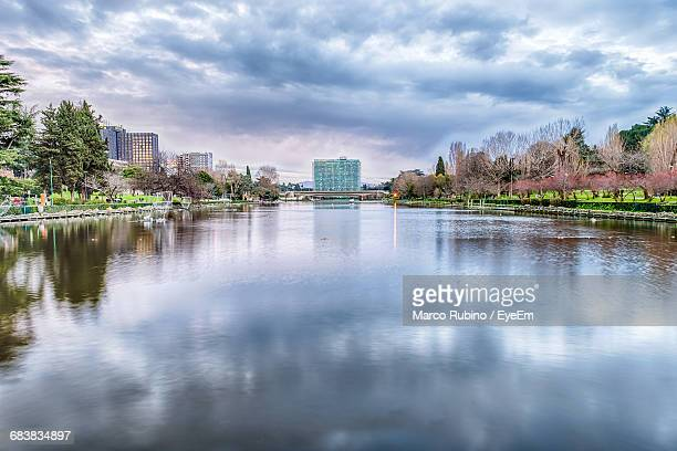 scenic view of artificial lake in eur district against cloudy sky - eur rome stock pictures, royalty-free photos & images