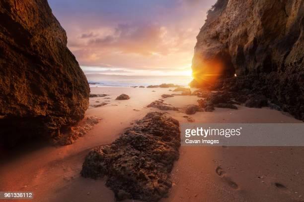 Scenic view of Atlantic ocean against cloudy sky during sunrise