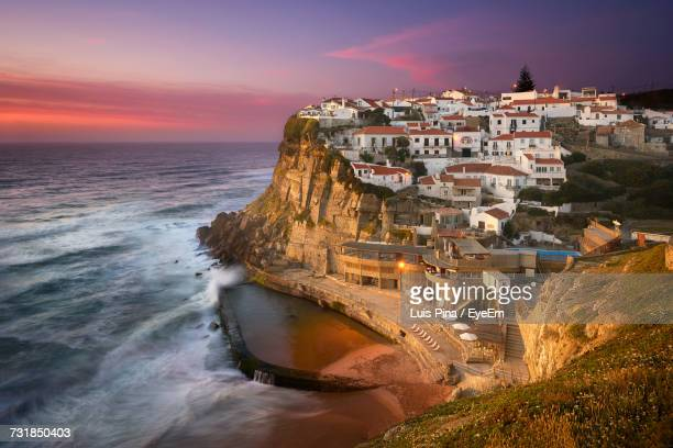 scenic view of azenhas do mar by sea against sky - lisbon stock pictures, royalty-free photos & images