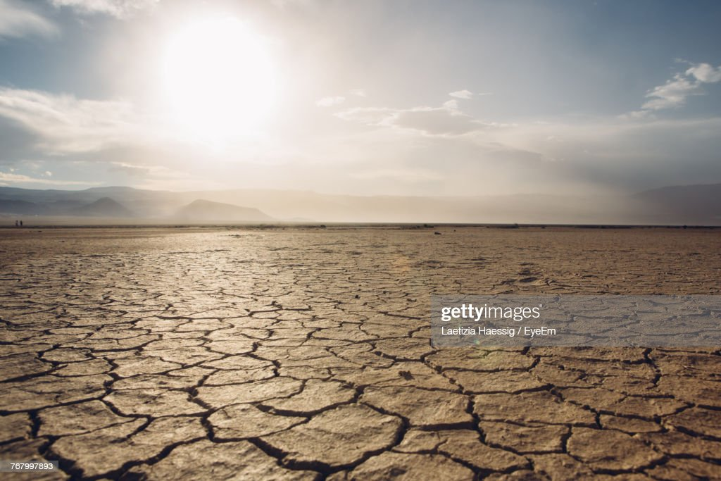 Scenic View Of Barren Landscape Against Sky : Stock Photo