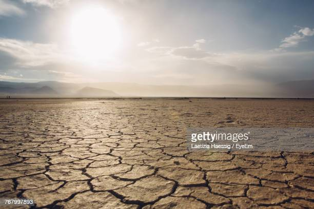 scenic view of barren landscape against sky - land stock-fotos und bilder