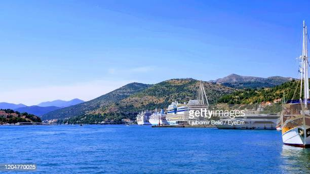 scenic view of bay against blue sky - ljubomir belic stock pictures, royalty-free photos & images