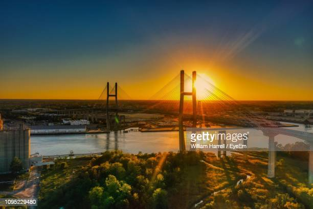 scenic view of bay against sky at sunset - savannah georgia stock pictures, royalty-free photos & images