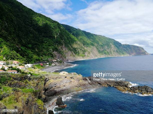 scenic view of bay against sky - madeira island stock photos and pictures
