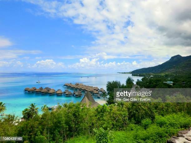 scenic view of bay against sky - tahiti stock pictures, royalty-free photos & images