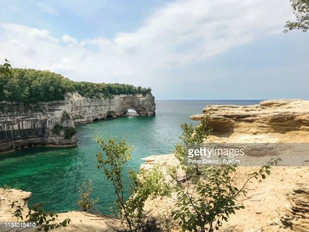 scenic view of bay against sky - pictured rocks national lakeshore stock pictures, royalty-free photos & images