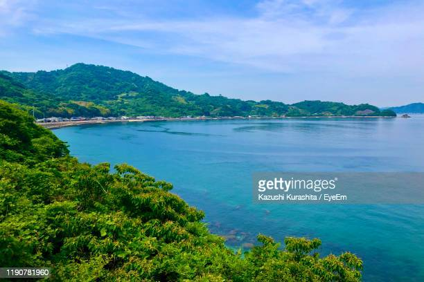 scenic view of bay against sky - matsuyama ehime stock pictures, royalty-free photos & images