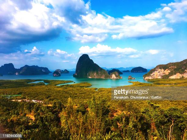 scenic view of bay against sky - panaikorn chutidaralux stock photos and pictures