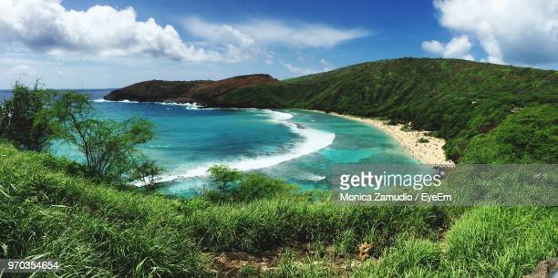scenic view of bay against sky - oahu stock pictures, royalty-free photos & images