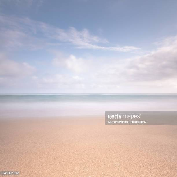 Scenic view of beach against a beautiful blue sky