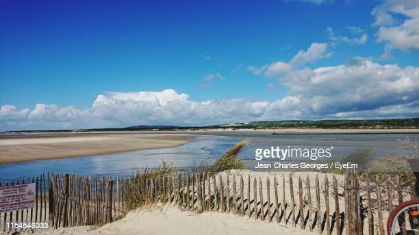 scenic view of beach against blue sky - le touquet paris plage stock pictures, royalty-free photos & images
