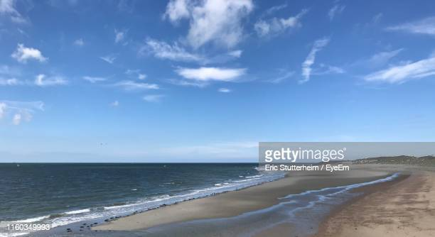 scenic view of beach against blue sky - stutterheim stock pictures, royalty-free photos & images