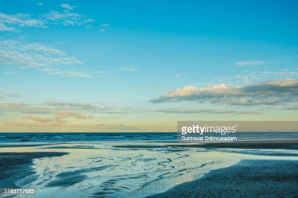 scenic view of beach against blue sky - chanthaburi sea stock pictures, royalty-free photos & images