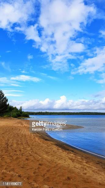 scenic view of beach against blue sky - norrbotten province stock pictures, royalty-free photos & images