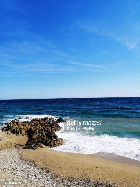 scenic view of beach against blue sky - var stock pictures, royalty-free photos & images