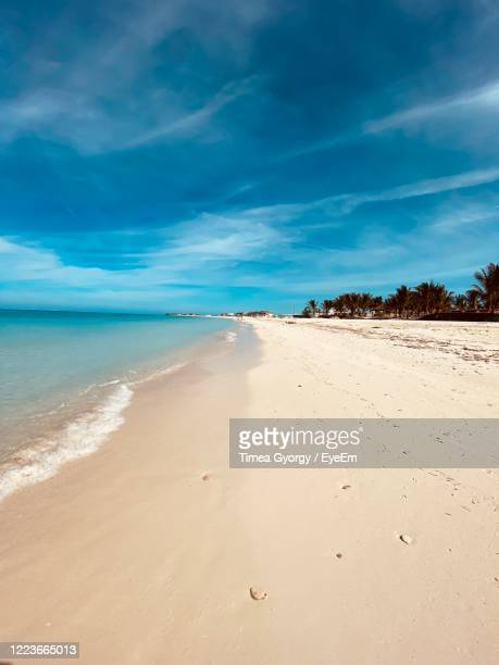 scenic view of beach against blue sky - bahamas stock pictures, royalty-free photos & images