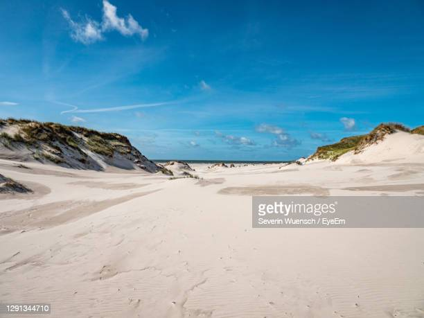 scenic view of beach against blue sky - germany stock pictures, royalty-free photos & images