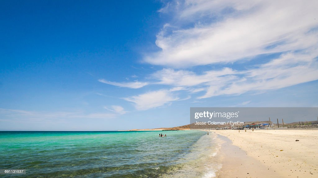 Scenic View Of Beach Against Blue Sky : Stock Photo