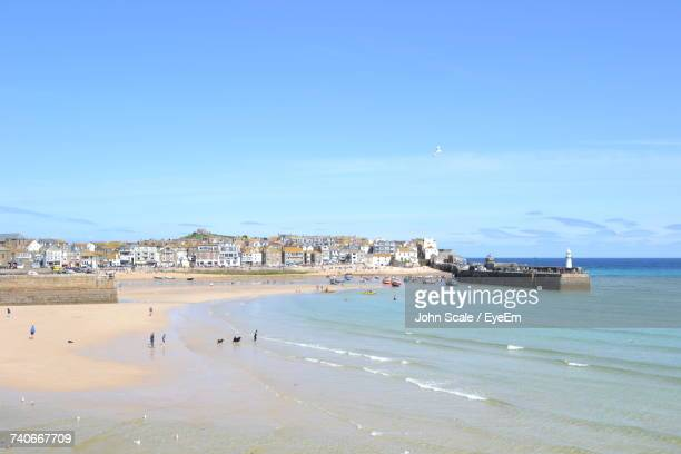 scenic view of beach against blue sky - st ives stock pictures, royalty-free photos & images