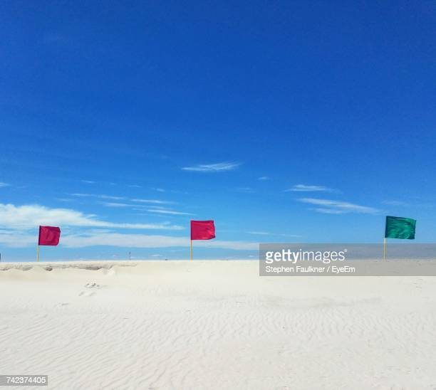 scenic view of beach against blue sky - wantagh stock pictures, royalty-free photos & images