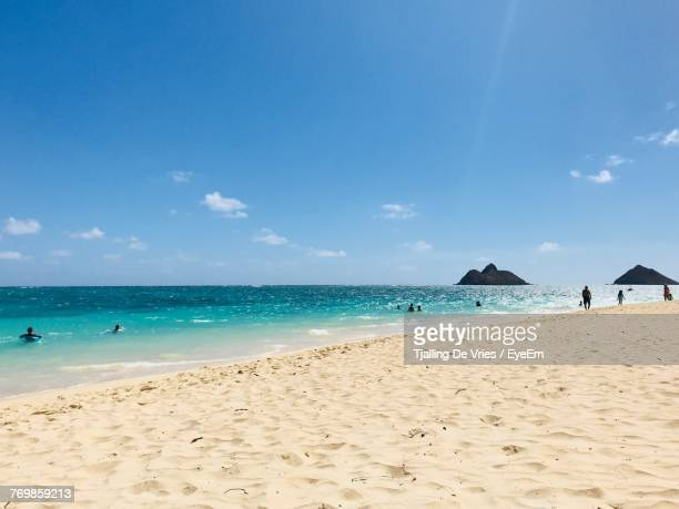 scenic view of beach against blue sky - kailua stock pictures, royalty-free photos & images