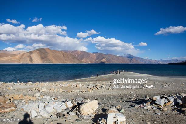 scenic view of beach against blue sky - indore stock photos and pictures
