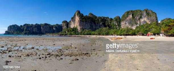 scenic view of beach against clear blue sky - marek stefunko - fotografias e filmes do acervo