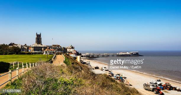 scenic view of beach against clear blue sky - pier stock pictures, royalty-free photos & images