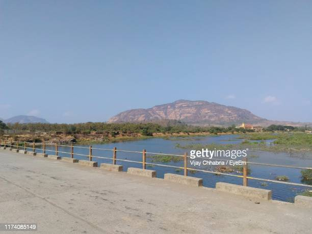 scenic view of beach against clear blue sky - maharashtra stock pictures, royalty-free photos & images