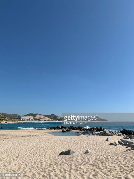 scenic view of beach against clear blue sky - mack stock pictures, royalty-free photos & images