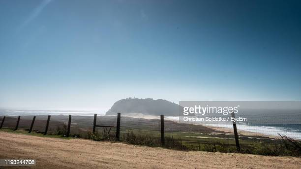 scenic view of beach against clear blue sky - christian soldatke foto e immagini stock