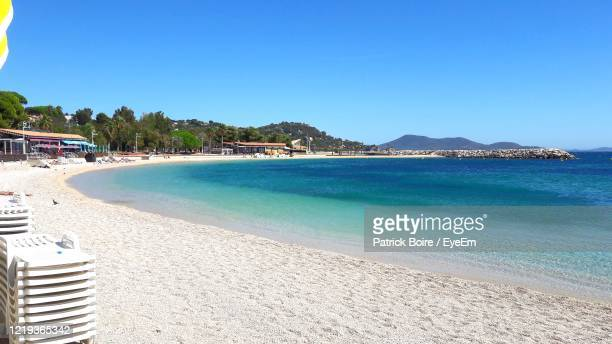 scenic view of beach against clear blue sky - var stock pictures, royalty-free photos & images