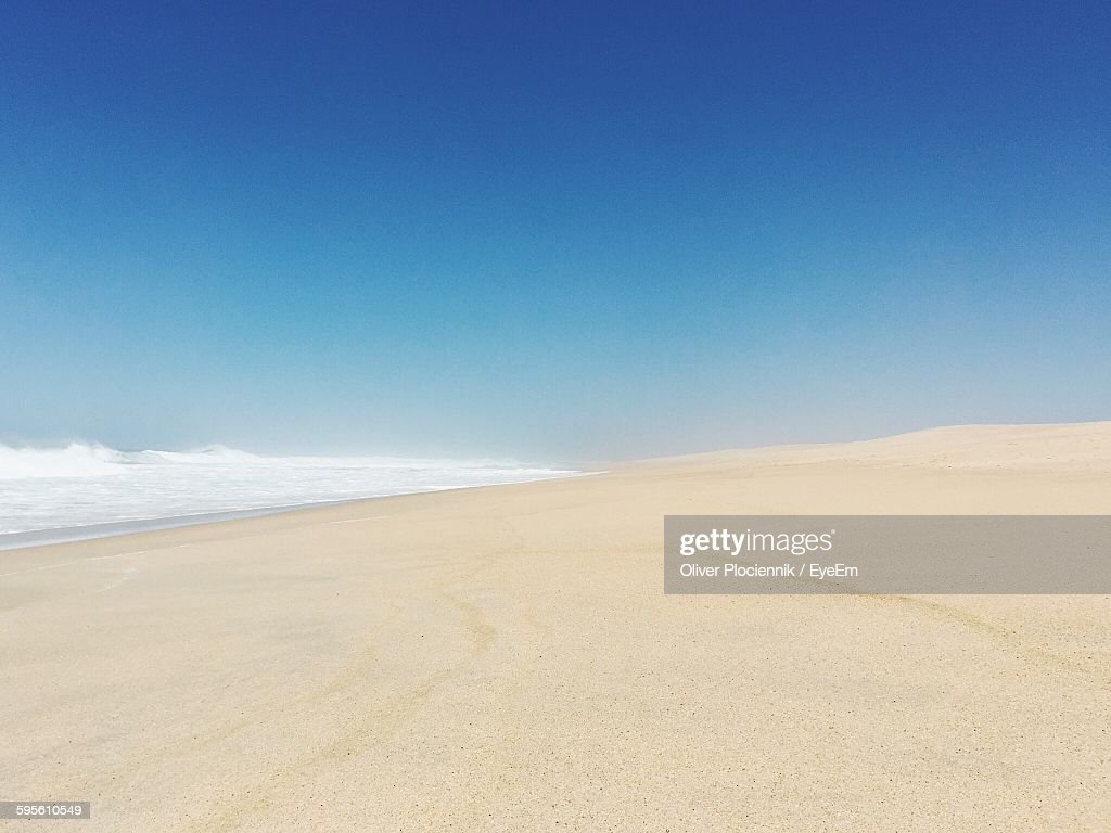 Scenic View Of Beach Against Clear Blue Sky : Foto de stock