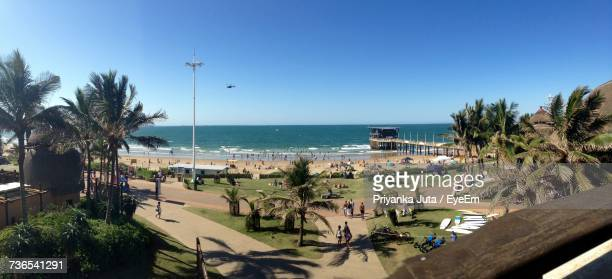 scenic view of beach against clear blue sky - durban stock pictures, royalty-free photos & images