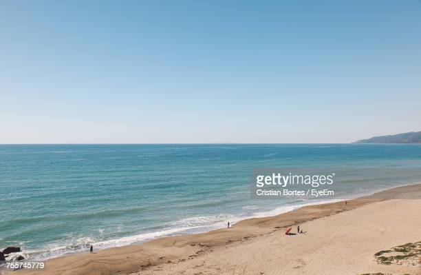 scenic view of beach against clear blue sky - bortes stock photos and pictures