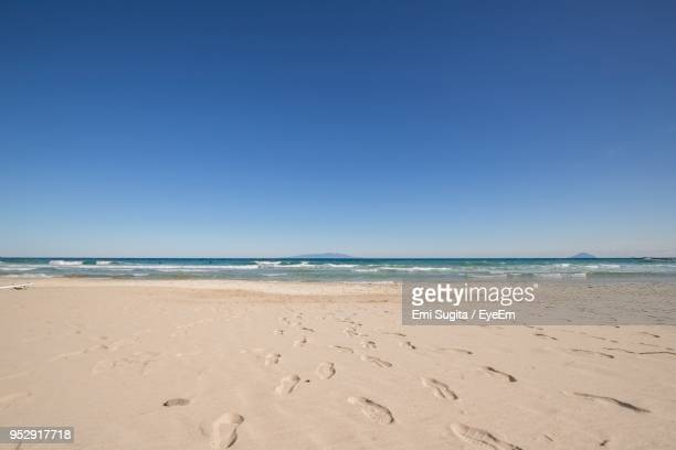 scenic view of beach against clear blue sky - shizuoka stock photos and pictures