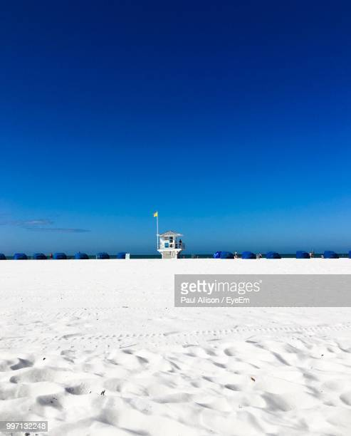 scenic view of beach against clear blue sky - clearwater beach stock pictures, royalty-free photos & images