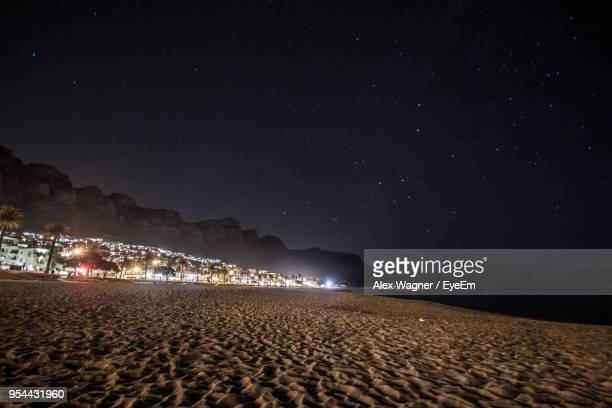 Scenic View Of Beach Against Clear Sky At Night