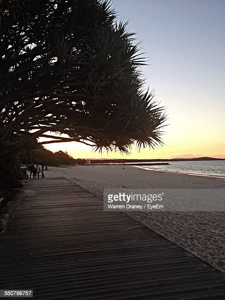Scenic View Of Beach Against Clear Sky At Sunset