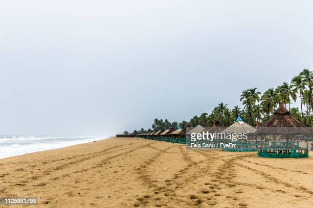 scenic view of beach against clear sky - lagos nigeria stock pictures, royalty-free photos & images