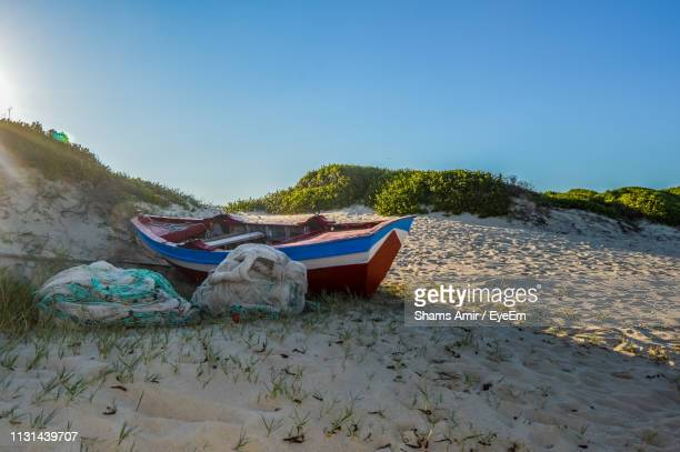 scenic view of beach against clear sky - maputo city stock pictures, royalty-free photos & images