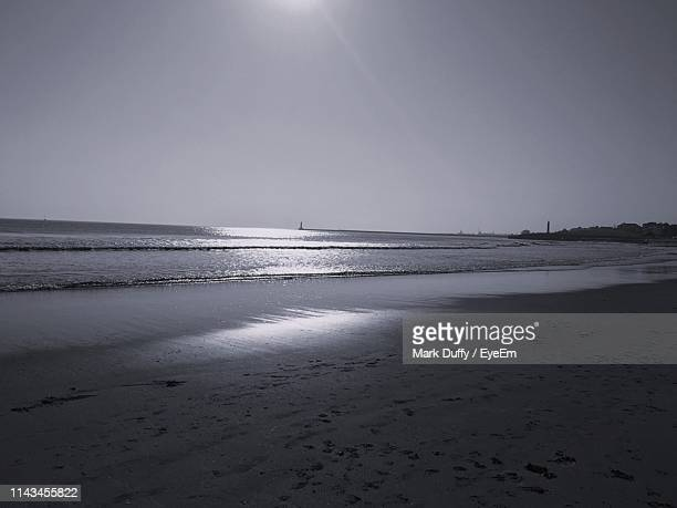 scenic view of beach against clear sky - mark's stock pictures, royalty-free photos & images