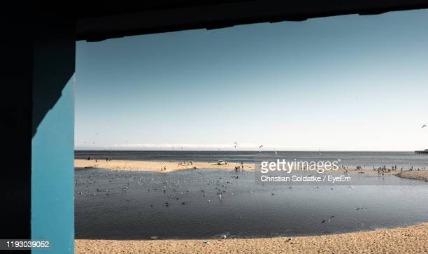 scenic view of beach against clear sky - christian soldatke stock pictures, royalty-free photos & images