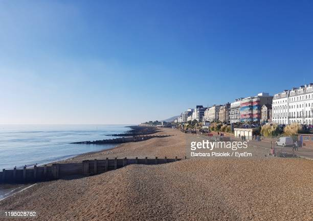 scenic view of beach against clear sky - eastbourne stock pictures, royalty-free photos & images