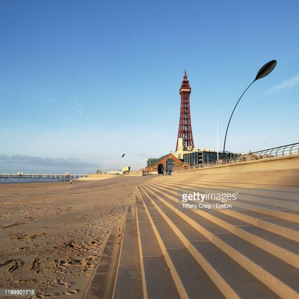 scenic view of beach against clear sky - blackpool beach stock pictures, royalty-free photos & images